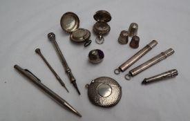 An Edward VII silver sovereign case, Birmingham, 1907, together with another silver sovereign case,