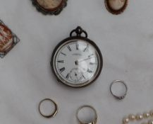 A late Victorian silver open faced pocket watch the circular enamel dial with Roman numerals and a