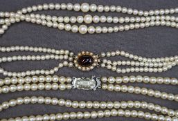 A three strand pearl necklace,