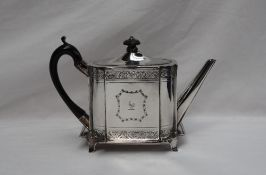 A Victorian silver teapot of rectangular form, decorated with bands of flowers and a straight spout,