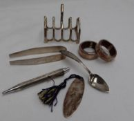 A George V silver four division toast rack, Birmingham, 1924, together with a silver bookmark,