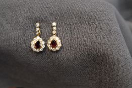A pair of 18ct yellow gold ruby and diamond drop earrings,