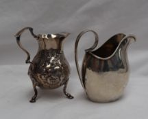 A George V silver cream jug with a scrolling handle, Sheffield, 1918,