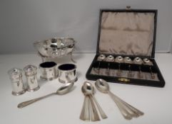 A George V silver bowl of lobed form, with alternating plain and pierced sides on splayed legs,