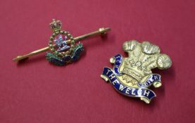"""A 9ct yellow gold """"Welch"""" Regiment pin badge,"""