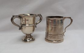 A George V silver twin handled trophy cup, Sheffield, 1930 together with a silver christening mug,