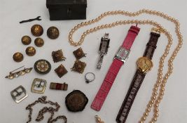 A Dali softwatch, together with other watches, faux pearls, military buttons,