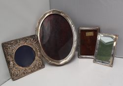 A George V silver photograph frame of oval form with line decoration and shaped edges, Chester,