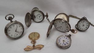 A George V silver half hunter pocket watch, the outer case with Roman numerals and a bulls eye,