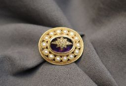 A 9ct yellow gold brooch of oval form,