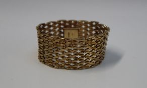 A 9ct yellow gold bracelet, with an interwoven crossover strap, 17.5cm long x 2.