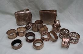A collection of various silver napkin rings,