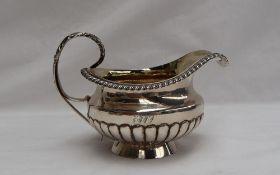 A George III silver cream jug,