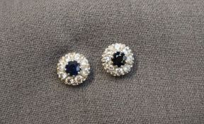 A pair of sapphire and diamond cluster earrings,