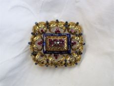 An 18ct yellow gold brooch of rectangular pierced leaf scrolling form, set with diamonds,