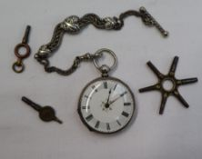A continental white metal fob watch, the enamel dial with Roman numerals, painted to the centre,