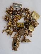 A yellow metal charm bracelet,