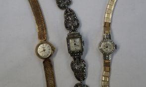 A Lady's 9ct yellow gold and diamond encrusted cocktail watch,