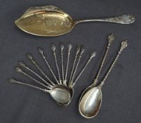 A set of eleven German 800 standard white metal spoons with shield tops and spiral stems together