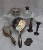 A continental white metal hand mirror and brush, together with dressing table pots,