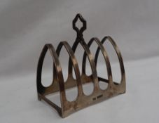 A George V silver four division toast rack, Sheffield, 1933, Viners Ltd,