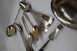 A set of seven continental white metal table spoons, each marked HA HA,