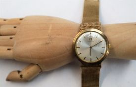 A Gentleman's 9ct yellow gold Omega wristwatch,