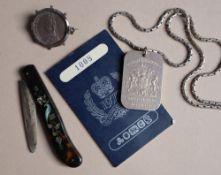 A silver ingot to commemorate the Silver Jubilee of Queen Elizabeth II in 1977,