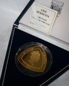 A 1996 Bermuda gold proof Triangular 180 dollars coin, No.48 / 99, 155.52 grams, .