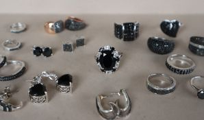 A black spinel and sterling silver dress ring, together with assorted black stone dress rings,