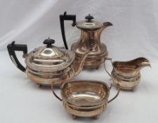 A George V silver four piece tea set comprising a teapot, hot water jug,
