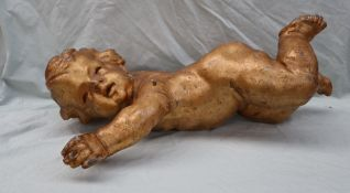 An 18th century gilt gesso cherub, with arms outstretched,