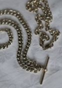 A silver Albert watch chain together with a silver necklace,