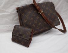 A Louis Vuitton monogram clutch bag, with a leather shoulder strap,