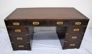 A 19th century mahogany campaign desk, the rectangular brass bound inset top above three drawers,