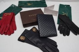 A Gucci black leather notebook,