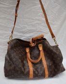 A Louis Vuitton monogram overnight bag, with leather straps,