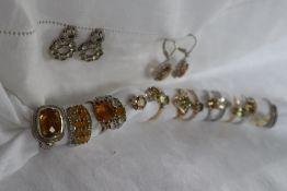 Five assorted semi precious gem set 9ct gold rings,