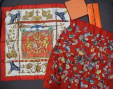 A Hermes silk scarf, Mineraux, in a pouch together with another Hermes scarf,