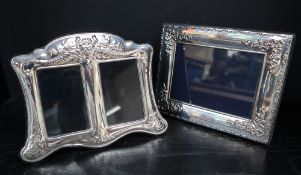 A modern silver photograph frame, of rectangular form, embossed with swags, flowers and leaves,