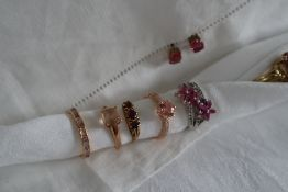 A 9ct gold pink topaz dress ring together with two other 9ct gold rings,