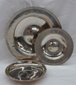 A modern silver dish of circular form with line decoration, London, 1973, 17cm diameter,