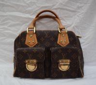A Louis Vuitton monogram handbag, with leather handles,
