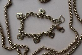 A 9ct yellow gold necklace and a 9ct gold bracelet with heart shaped charms,