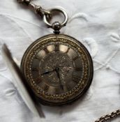 A continental white metal open faced pocket watch, the silvered dial with Roman numerals ,