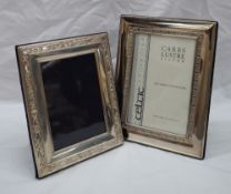 A modern silver photograph frame, of rectangular form with a Celtic pattern,