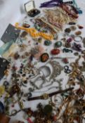 A large quantity of costume jewellery including brooches,