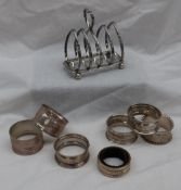 An Edward VII Silver toast rack with four divisions on ball feet, Sheffield, 1906,
