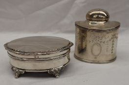 A George V silver tea caddy of oval form, decorated with swags and festoons to a vacant cartouche,