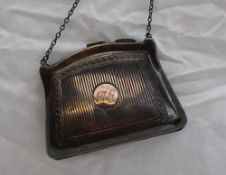 A silver purse, of usual form, with Greek key and line decoration, possibly 1917,
